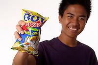 Montreal (Qc) Canada - august 19 2009 - model release photo - A Filipino  male teen eating boy bawang ; fried corn