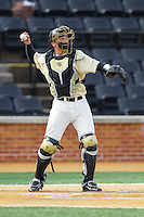Wake Forest Demon Deacons catcher Garrett Kelly (28) throws the ball back to his pitcher during the game against the Marshall Thundering Herd at Wake Forest Baseball Park on February 17, 2014 in Winston-Salem, North Carolina.  The Demon Deacons defeated the Thundering Herd 4-3.  (Brian Westerholt/Four Seam Images)