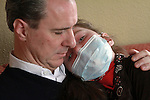 William Massart holds his daughter Sandra Massart, 10, at the family's apartment in Durham, NC, USA, on Tuesday, Feb. 14, 2012.  Sandra Massart is being treated for MLD, a degenerative condition.  Photo by Ted Richardson