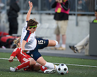 25 May 09:  USA National midfielder Megan Rapinoe #15 gets slide tackled in an International Friendly soccer game between the US Women's Team and the Canadian Women's Team at BMO Field in Toronto..The US Women's Team won 4-0..