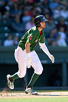 Designated hitter C.J. Chatham (10) of the Greenville Drive bats runs out a batted ball in a game against the Charleston RiverDogs on Sunday, April 29, 2018, at Fluor Field at the West End in Greenville, South Carolina. Greenville won, 2-0. (Tom Priddy/Four Seam Images)