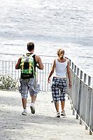 Escursionisti percorrono la Via dell'Amore tra Riomaggiore e Manarola, alle Cinque Terre.<br /> Hikers walk the Via dell'Amore (Love Street) between Riomaggiore and Manarola at the Cinque Terre.<br /> UPDATE IMAGES PRESS/Riccardo De Luca