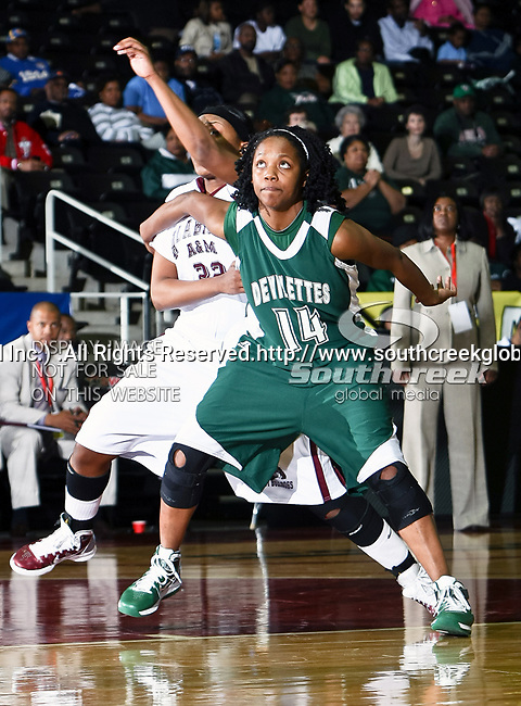 Mississippi Valley State Devilettes forward Khristina Clemons (14) and Alabama A&M Bulldogs forward Chelsea Marshall (22) in action during the SWAC Tournament game between the Mississippi Valley State Devilettes and the Alabama A&M Bulldogs at the Special Events Center in Garland, Texas. Mississippi Valley State defeats Alabama A & M 52 to 51