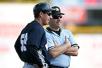 February 25, 2009:  Coach Rob Thomson (59) of the New York Yankees and third base umpire Damien Beal during a Spring Training game at Dunedin Stadium in Dunedin, FL.  The New York Yankees defeated the Toronto Blue Jays 6-1.   Photo by:  Mike Janes/Four Seam Images