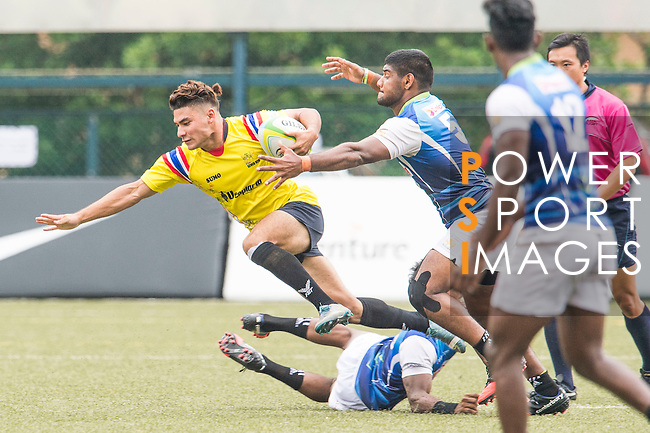 Baramee Thaiset (l) of Thailand battles for the ball during the match between Sri Lanka and Thailand of the Asia Rugby U20 Sevens Series 2016 on 12 August 2016 at the King's Park, in Hong Kong, China. Photo by Marcio Machado / Power Sport Images