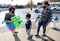 Students visit with Ruth Mobley, assistant principal at Washington Elementary School, as she holds a sign up Thursday, Nov. 19, 2020, asking cars to honk as she stands in a tutu and tiara on the corner of Lafayette Street and College Avenue in Fayetteville. Mobley agreed to hold the sign if the students at the school would collect 500 boxes of macaroni and cheese for the school district food pantry and 200 pairs of socks for 7 Hills Homeless Center in Fayetteville. Check out nwaonline.com/201120Daily/ and nwadg.com/photos for a photo gallery.(NWA Democrat-Gazette/David Gottschalk)