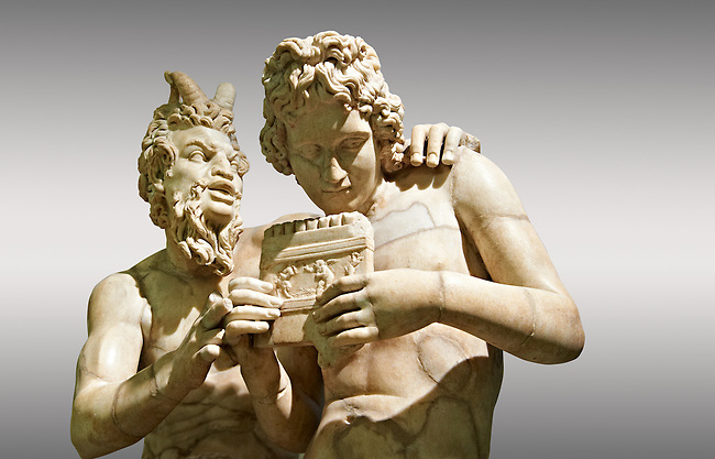 2nd century AD Roman marble sculpture of Pan teaching Daphnis to play the pipes, a Roman copy late 2nd century BC Hellenistic Geek original attributed to Rodes sculptor Heliodoros. Pan's and Daphnis' heads and Daphnis' right arm are restorations.  The Farnese collection, Naples Museum of Archaeology, Italy