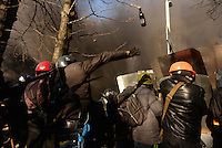 Protesters throw petrol bombs towards the riot police. Kiev, Ukraine