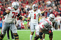 Indianapolis, IN - December 8, 2019: Ohio State Buckeyes quarterback Justin Fields (1) changes the play during the Big Ten championship game Wisconsin and Ohio St. at Lucas Oil Stadium in Indianapolis, IN.   (Photo by Elliott Brown/Media Images International)