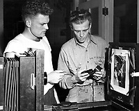 Students working in the Naval School of Photography.  Here a student is learning from his instructor the element of exposure variation in making a copy on a copying camera.  [Name on shirt: Le Pierre]