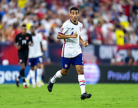 NASHVILLE, TN - SEPTEMBER 5: Tyler Adams #4 of the United States runs across the field during a game between Canada and USMNT at Nissan Stadium on September 5, 2021 in Nashville, Tennessee.