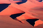 ONLINE ARE RESTRICTED TO A MAXIMUM OF 10 IMAGES  FROM THIS SET TO RUN ALONGSIDE THE STORY<br /> <br /> Pictured: Taken from a plane:  Sand dunes at Sossusvlei, a salt and clay pan surrounded by high red dunes, located in the southern part of the Namib Desert, in the Namib-Naukluft National Park of Namibia.<br /> <br /> Amazing drone shots show a Mongolian tribesman sledding across a frozen lake, the skyscrapers of Dubai shrouded in mist and a fluorescent blue stream winding its way through the ice of Greenland.  Other images show fields of flowers in Italy and a herd of livestock being guided through the desert.<br /> <br /> The patterned pictures - which resemble modern art - were captured by photographer Alessandra Meniconzi from Lugano, Switzerland.  SEE OUR COPY FOR DETAILS.<br /> <br /> Please byline: Alessandra Meniconzi/Solent News<br /> <br /> © Alessandra Meniconzi/Solent News & Photo Agency<br /> UK +44 (0) 2380 458800