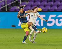 ORLANDO, FL - JANUARY 22: Jéssica Caro #8 and Rose Lavelle #16 battle for the ball during a game between Colombia and USWNT at Exploria stadium on January 22, 2021 in Orlando, Florida.