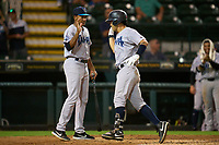 Tampa Tarpons Antonio Gomez (5) high fives Nicio Rodriguez (29) after hitting a home run during Game One of the Low-A Southeast Championship Series against the Bradenton Marauders on September 21, 2021 at LECOM Park in Bradenton, Florida.  (Mike Janes/Four Seam Images)
