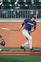 Joe Gellenbeck (19) of the Xavier Musketeers follows through on his swing against the Charlotte 49ers at Hayes Stadium on March 3, 2017 in Charlotte, North Carolina.  The 49ers defeated the Musketeers 2-1.  (Brian Westerholt/Four Seam Images)