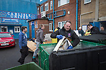 Carlisle, 09/12/2015. Brunton Park. A volunteer clearing damaged goods from offices at Brunton Park, home of Carlisle United Football Club following flooding at the stadium. Record rain fall in Cumbria caused flooding to several areas of Carlisle, causing houses to be evacuated by emergency services. Photo by Colin McPherson.