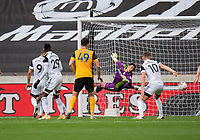 Fulham's Alphonse Areola (Centre) under pressure as he dives to clear the ball <br /> <br /> Photographer David Horton/CameraSport<br /> <br /> The Premier League - Wolverhampton Wanderers v Fulham - Sunday 4th October 2020 - Molineux Stadium - Wolverhampton<br /> <br /> World Copyright © 2020 CameraSport. All rights reserved. 43 Linden Ave. Countesthorpe. Leicester. England. LE8 5PG - Tel: +44 (0) 116 277 4147 - admin@camerasport.com - www.camerasport.com