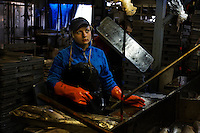 .Woman in fish processing plant is:.Nadezhda Usik.