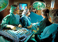 Doctors and nurses performing surgery. Billboard and broadcast must be negotiated, due to talent agreement.