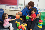 Education Preschool Phase-in First Days of School Head Start Early Learn 2s program female teacher with two students in classroom
