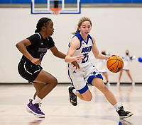 Ava Maner (23) of Rogers drives to the basket, as Wynter Beck (14) of Fayetteville at King Arena, Rogers, AR January 8, 2021 / Special to NWA Democrat-Gazette/ David Beach