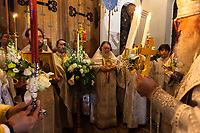 """Switzerland. Geneva. Easter at the Russian Church. The church is a lovely 19th-century Russian Orthodox church and designed in a Byzantine Moscovite style. The church's full name is Cathédrale de l'Exaltation de la Sainte Croix. After midnight on the night of Easter Sunday, the Archbishop Michael (R), priests, deacons and congregation go in a procession around the church, holding lit candles, chanting: By Thy Resurrection O Christ our savior, the angels in Heaven sing, enable us who are on Earth, to glorify thee in purity of heart. This procession reenacts the journey of the Myrrhbearers to the Tomb of Jesus """"very early in the morning"""". After circling around the church once, the procession halts in front of the church's closed doors which represent the sealed tomb. The nighttime liturgy is a blessing of Easter fire with candles and the celebration of the Easter Proclamation of the Resurrection of Jesus Christ. A priest holds in his hands the Paschal Trikirion which is a liturgical triple-candlestick used at Easter time in the Eastern Orthodox ceremony. It is used from the commencement of the celebration of the Resurrection during the Paschal Vigil. Archbishop Michael (Secular name - Simeon Vasilyevich Donskoff; born on 29 March 1943) is a bishop of the Russian Orthodox Church Outside of Russia, Archbishop of Geneva and Western Europe. Easter, also called Pascha or Resurrection Sunday is a festival and holiday celebrating the resurrection of Jesus from the dead, described in the New Testament as having occurred on the third day of his burial after his crucifixion.The Russian church serves not only the Russian community but also Bulgarians, Serbs, Coptic Christians and other Orthodox worshippers who do not have their own church in Geneva. 16.04.17 © 2017 Didier Ruef"""