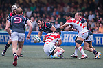Shintaro Ishihara of Japan (C) puts a tackle on Daniel Falvey (L) during the Asia Rugby Championship 2017 match between Hong Kong and Japan on May 13, 2017 in Hong Kong, China. Photo by Marcio Rodrigo Machado / Power Sport Images