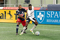 FOXBOROUGH, MA - OCTOBER 19: Andrew Farrell #2 of New England Revolution comes in to tackle Cory Burke #19 of Philadelphia Union during a game between Philadelphia Union and New England Revolution at Gillette on October 19, 2020 in Foxborough, Massachusetts.
