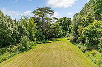 BNPS.co.uk (01202) 558833. <br /> Pic: Strutt&Parker/BNPS<br /> <br /> Pictured: View over gardens. <br /> <br /> Nun like it...<br /> <br /> A former convent that has hardly been touched in 80 years is on the market for £450,000.<br /> <br /> Until recently Posbury House was home to an Anglican Franciscan nunnery which moved to the Devon property to escape the danger of German bombardment in the Second World War.<br /> <br /> The eight-bedroom manor house and two acres of gardens have been well looked after by the nuns, but the property is now in need of refurbishment and buyers are relishing the idea of a project.<br /> <br /> Estate agents Strutt & Parker say the property has attracted an extraordinary amount of interest with more than 150 viewings in just ten days. They are now asking for best and final offers by midday on Wednesday.