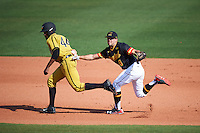 Maryland Terrapins shortstop Kevin Smith (4) tags Hunter Phillips (44) out during a game against the Alabama State Hornets on February 19, 2017 at Spectrum Field in Clearwater, Florida.  Maryland defeated Alabama State 9-7.  (Mike Janes/Four Seam Images)