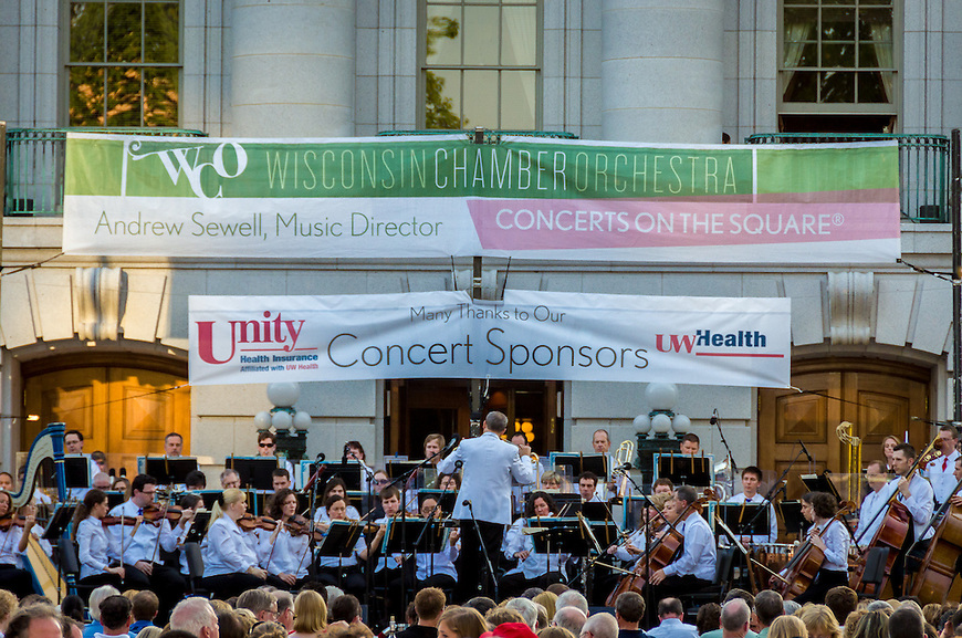 The Wisconsin Chamber Orchestra performs in front of the Wisconsin State Capitol during a Concert of the Square conducted by Andrew Sewell.