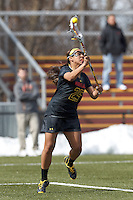 University of Maryland midfielder/defender Jen Mendez (25) passes the ball. .University of Maryland (black) defeated Boston College (white), 13-5, on the Newton Campus Lacrosse Field at Boston College, on March 16, 2013.