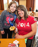 Calgary, AB - June 5 2014 - Ina Forrest shows off her medal during the Celebration of Excellence Heroes Tour visit to Ronald McDonald House in Calgary. (Photo: Matthew Murnaghan/Canadian Paralympic Committee)