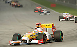 05 Apr 2009, Kuala Lumpur, Malaysia --- ING Renault F1 Team driver Fernando Alonso of Spain leads the pack during the 2009 Fia Formula One Malasyan Grand Prix at the Sepang circuit near Kuala Lumpur. Photo by Victor Fraile --- Image by © Victor Fraile / The Power of Sport Images