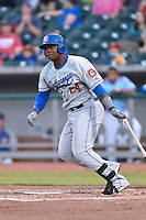 Chattanooga Lookouts third baseman Miguel Sano (24) swings at a pitch during a game against the Tennessee Smokies on April 25, 2015 in Kodak, Tennessee. The Smokies defeated the Lookouts 16-10. (Tony Farlow/Four Seam Images)