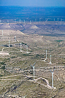 aerial photograph of a wind farm in west Texas; an additional wind farm is visible in the distant background near the horizon