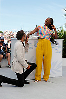 """CANNES, FRANCE - JULY 17: French actress Fatou N'Diaye and Pierre Niney at photocall for the film """"OSS 117 : Alerte Rouge en Afrique Noire"""" (OSS 117 : From Africa With Love) at the 74th annual Cannes Film Festival in Cannes, France on July 17, 2021 <br /> CAP/GOL<br /> ©GOL/Capital Pictures"""