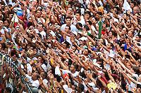 Promesseiro tentam chegar perto fotografando Nossa Senhora durante o Círio em homenagem a Nossa Senhora de Nazaré.14/10/2012Belém, Pará, Brasil.Foto Paulo Santos/Interfoto