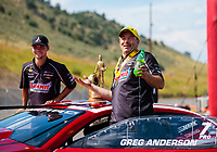 Jul 21, 2019; Morrison, CO, USA; NHRA pro stock driver Greg Anderson and son Cody Anderson celebrate after winning the Mile High Nationals at Bandimere Speedway. Mandatory Credit: Mark J. Rebilas-USA TODAY Sports