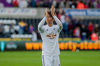 Saturday 4th  October 2014 Pictured: Ki Sung-Yueng of Swansea City applauds fans as he leaves the field <br /> Re: Barclays Premier League Swansea City v Newcastle United at the Liberty Stadium, Swansea, Wales,UK