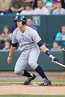 Hunter Dozier (18) of the Wilmington Blue Rocks follows through on his swing against the Winston-Salem Dash at BB&T Ballpark on April 3, 2014 in Winston-Salem, North Carolina.  The Blue Rocks defeated the Dash 3-1.  (Brian Westerholt/Four Seam Images)
