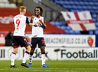 Bolton Wanderers' Peter Kioso (right) celebrates with team mate Eoin Doyle after an own goal scored by Salford City<br /> <br /> Photographer Andrew Kearns/CameraSport<br /> <br /> The EFL Sky Bet League Two - Bolton Wanderers v Salford City - Friday 13th November 2020 - University of Bolton Stadium - Bolton<br /> <br /> World Copyright © 2020 CameraSport. All rights reserved. 43 Linden Ave. Countesthorpe. Leicester. England. LE8 5PG - Tel: +44 (0) 116 277 4147 - admin@camerasport.com - www.camerasport.com