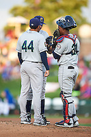 Cedar Rapids Kernels pitching coach Henry Bonilla (44) talks with pitcher Keaton Steele (27) and catcher Brian Navarreto (21) during a game against the South Bend Cubs on June 5, 2015 at Four Winds Field in South Bend, Indiana.  South Bend defeated Cedar Rapids 9-4.  (Mike Janes/Four Seam Images)