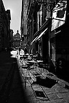 Late afternoon shadows at a cafe in Genoa, Italy.