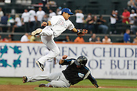 Buffalo Bisons second baseman Luis Hernandez #1 jumps for over a sliding Seth Bynum #11 while reaching for a throw that went to centerfield during a game against the Syracuse Chiefs at Coca-Cola Field on September 1, 2011 in Buffalo, New York.  Syracuse defeated Buffalo 6-2.  (Mike Janes/Four Seam Images)
