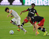 WASHINGTON, DC - NOVEMBER 8: Bojan #9 of Montreal Impact battles for the ball with Moses Nyeman #27 of D.C. United and Russell Canouse #4 of D.C. United during a game between Montreal Impact and D.C. United at Audi Field on November 8, 2020 in Washington, DC.