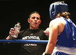 Coach Joey Gilbert talks to Nevada boxer McKain Murdock during the National Collegiate Boxing Association action in Reno, Nev. on Friday, Jan. 31, 2020. Murdock won the bout. <br /> Photo by Cathleen Allison