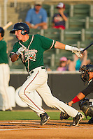Chase Austin #8 of the Greensboro Grasshoppers follows through on his swing against the Kannapolis Intimidators at Fieldcrest Cannon Stadium August 3, 2010, in Kannapolis, North Carolina.  Photo by Brian Westerholt / Four Seam Images