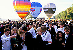 DRINKING, KISSING, EMBRACING, COUPLES IN A CROWD OF REVELLERS GATHERED OUTSIDE AT THE CIRENCESTER ROYAL BALL, 1990, 1990