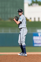 Peoria Javelinas relief pitcher Wyatt Mills (25), of the Seattle Mariners organization, gets ready to deliver a pitch during an Arizona Fall League game against the Surprise Saguaros at Surprise Stadium on October 17, 2018 in Surprise, Arizona. (Zachary Lucy/Four Seam Images)